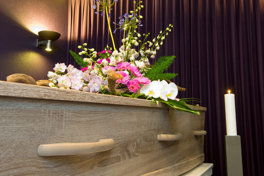 coffin and purple curtain
